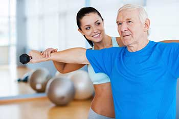 Elderly Man working with Physical Therapist
